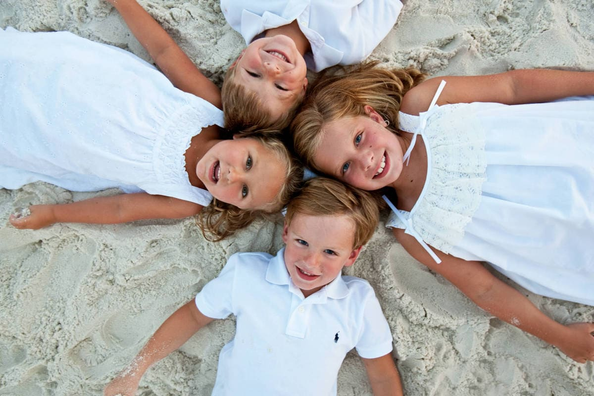 children playing on the sand orange beach al 210190-242