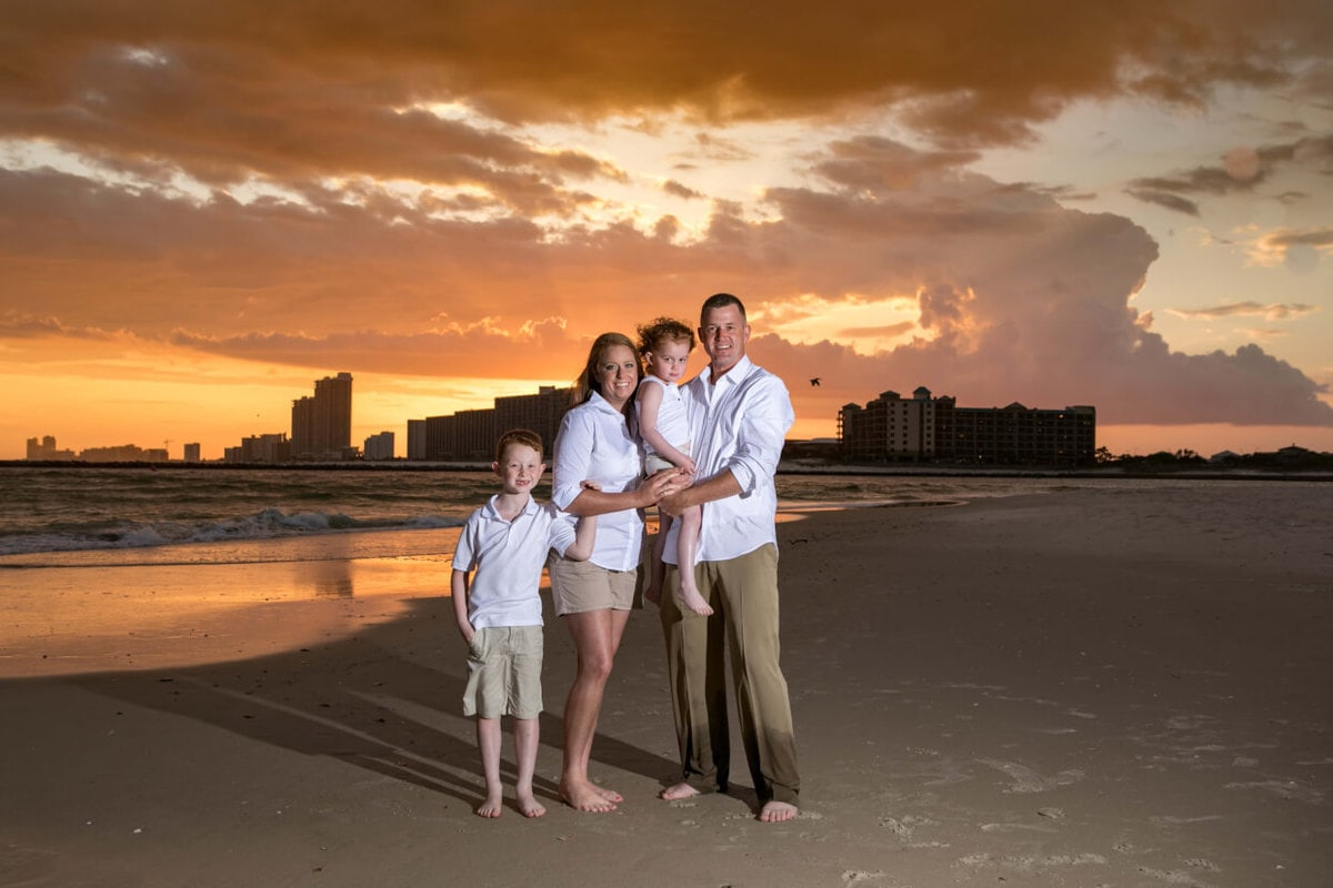 orange beach family sunset