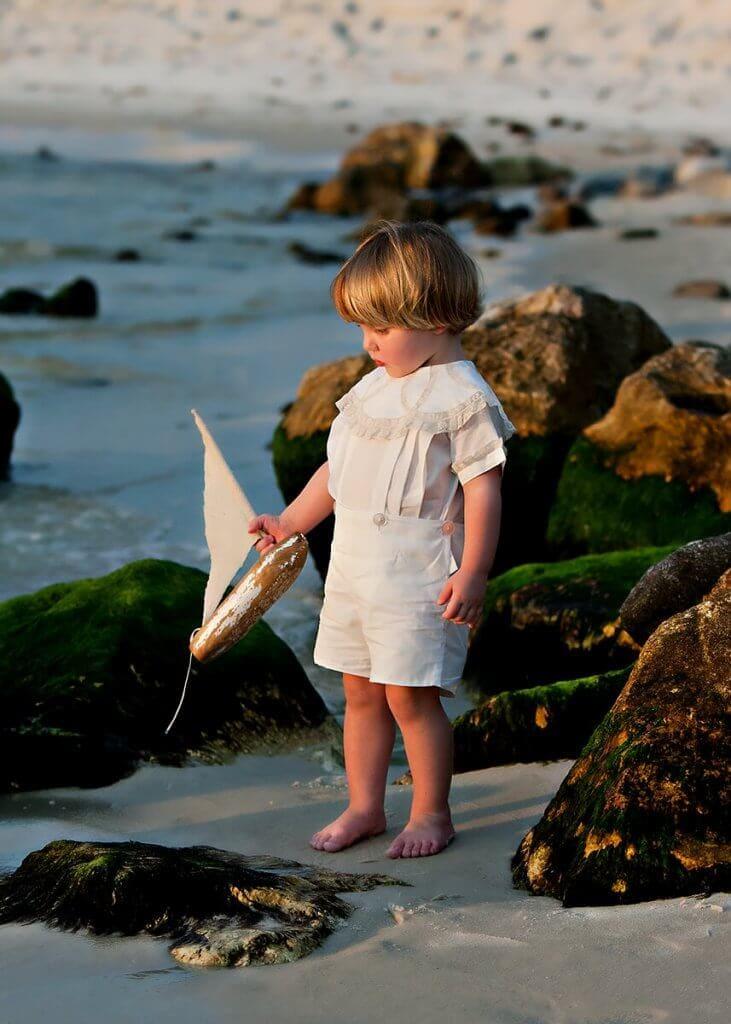 family-photography-boy-boat-orange-beach-al