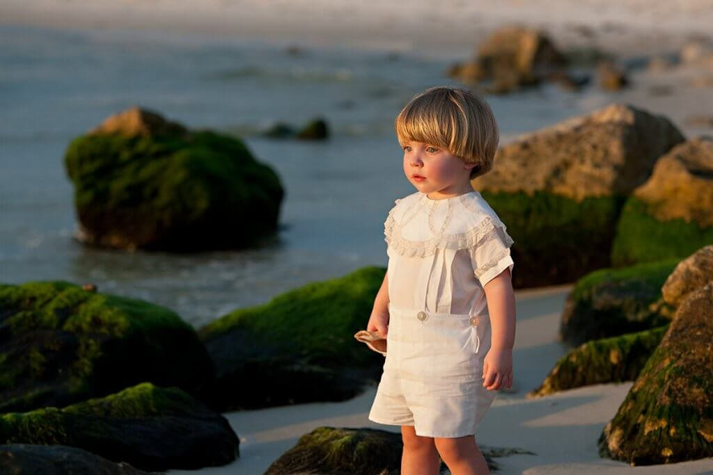 family-photography-boy-shells-orange-beach-al-