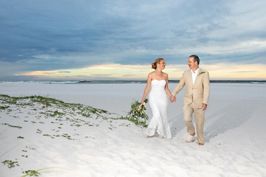 wedding photography bride and groom holding gands